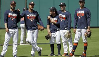 Houston Astros, from left to right, Marwin Gonzalez, Yuli Gurriel, Jose Altuve, Alex Bregman and Carlos Correa watch outfielders hit during baseball practice Wednesday, Oct. 11, 2017, in Houston. The Astros beat the Boston Red Sox to advance to the ALCS, which is set to begin Friday. (AP Photo/David J. Phillip)