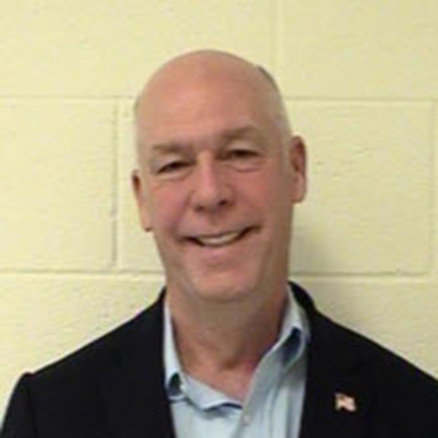 This Aug. 25, 2017 photo provided by Gallatin County, Mont. shows U.S. Rep. Greg Gianforte, R-Mont., at the Gallatin County Detention Center in Bozeman, Mont. On Wednesday, Sept. 11, 2017, Gallatin County District Judge Holly Brown ordered the release of the mugshot made after the state's lone congressman was convicted of assaulting Guardian reporter Ben Jacobs on the eve of the special election that put him in office. (Gallatin County via AP)