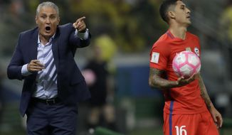 Brazil's coach Tite, left, shouts instructions to his players and Chile's Pedro Hernandez gets ready to throw in the ball during a World Cup qualifying soccer match in Sao Paulo, Brazil, Tuesday, Oct. 10, 2017. (AP Photo/Andre Penner)