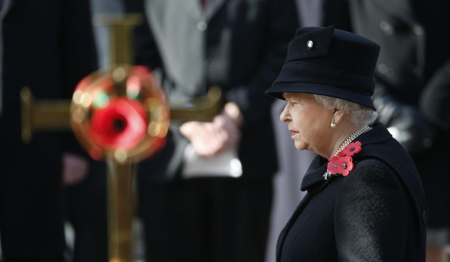 FILE - A Sunday, Nov. 13, 2016 file photo of Britain's Queen Elizabeth II taking part in the Remembrance Sunday service at the Cenotaph in London. Queen Elizabeth II will not personally place a wreath on The Cenotaph on Remembrance Sunday this year. The aging monarch and her husband Prince Philip will instead watch the ceremony from a balcony at the Foreign & Commonwealth Office. (AP Photo/Alastair Grant, File)