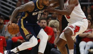 New Orleans Pelicans' DeMarcus Cousins, left, is guarded by Chicago Bulls' Cristiano Felicio during the second half of a preseason NBA basketball game Sunday, Oct. 8, 2017, in Chicago. (AP Photo/Jim Young)