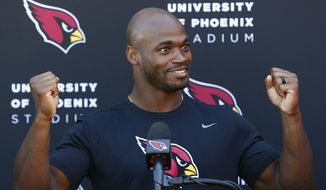 New Arizona Cardinals running back Adrian Peterson answers a question about being traded to the Cardinals during an NFL football news conference at the team's training facility Wednesday, Oct. 11, 2017, in Tempe, Ariz. (AP Photo/Ross D. Franklin)