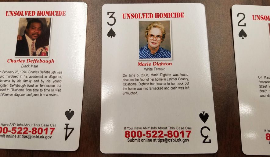 Playing cards featuring unsolved and unidentified homicides or missing person cases are displayed at Oklahoma State Bureau of Investigation headquarters in Oklahoma City, Wednesday, Oct. 11, 2017. Oklahoma State Bureau of Investigation Director and Oklahoma Department of Correction Director have joined to sell the playing cards to the state prison inmates.  (AP Photo/Ken Miller)