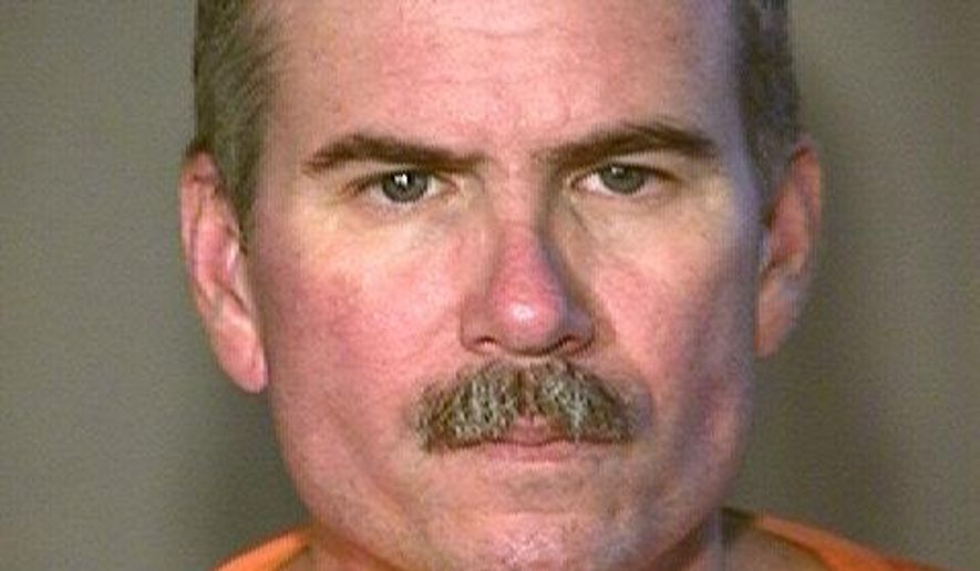 This undated booking photo provided by the Arizona Department of Corrections shows Jack Hudson, a former undercover narcotics officer serving life terms for killing two fellow law enforcement officers in Yuma 22 years ago. The Arizona Department of Corrections says 59-year-old Hudson died Tuesday, Oct. 11, 2017, of natural causes in the health unit at the Lewis prison complex in Buckeye, a Phoenix suburb. (Arizona Department of Corrections via AP)