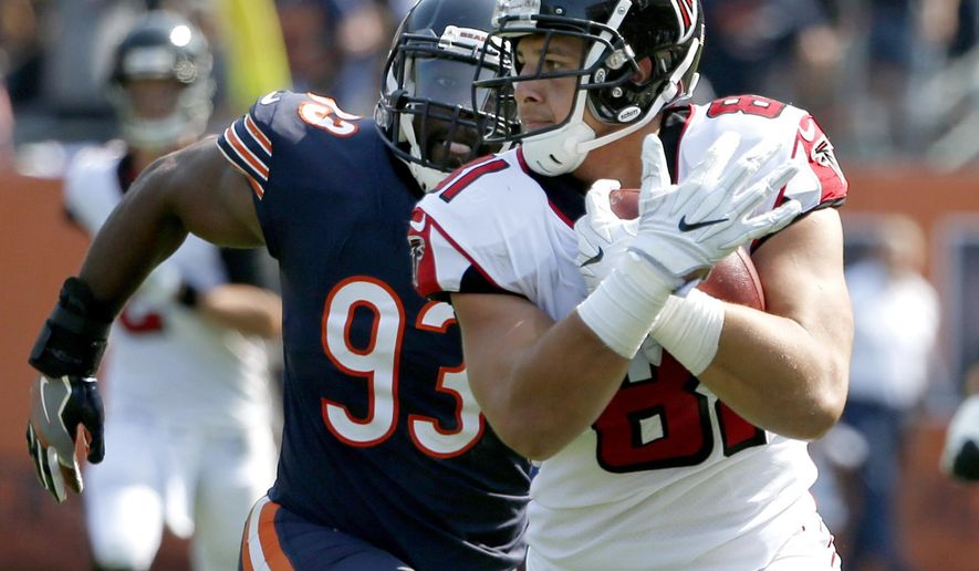 FILE - In this Sept. 10, 2017, file photo, Atlanta Falcons tight end Austin Hooper (81) runs past Chicago Bears linebacker Sam Acho (93) after making a pass reception during the second half of an NFL football game in Chicago. Falcons quarterback Matt Ryan may still be without No. 2 receiver Mohamed Sanu against Miami on Sunday. That could lead to bigger roles for Taylor Gabriel and tight end Austin Hooper. (AP Photo/Nam Y. Huh, File)