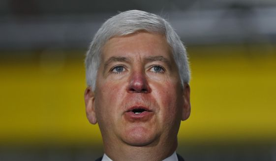 FILE - In this Sept. 18, 2017 file photo, Michigan Gov. Rick Snyder speaks at American Axle & Manufacturing in Auburn Hills, Mich. Gov. Snyder is sticking by his congressional testimony about when he learned about a fatal outbreak of Legionnaires' disease during the Flint water crisis, despite a senior aide's new disclosure that he informed the Republican governor weeks earlier. Some Democrats in Congress are pouncing on the conflict and urging the U.S. House Oversight and Government Reform Committee to investigate. (AP Photo/Paul Sancya, File)