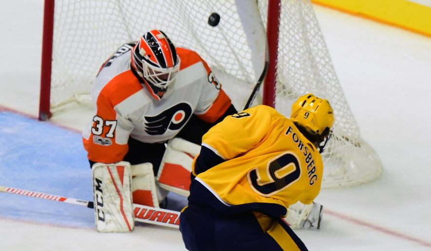 Nashville Predators left wing Filip Forsberg (9) scores past Philadelphia Flyers goalie Brian Elliott (37) in the third period of an NHL hockey game Tuesday, Oct. 10, 2017, in Nashville, Tenn. (AP Photo/Mike Strasinger)