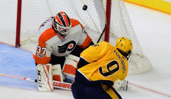 Nashville Predators left wing Filip Forsberg (9) scores past Philadelphia Flyers goalie Brian Elliott (37) in the third period of an NHL hockey game Tuesday, Oct. 10, 2017, in Nashville, Tenn. (AP Photo/Mike Strasinger)