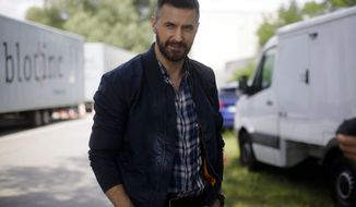 """In this Wednesday, June 28, 2017 photo, actor Richard Armitage talks to the AP during an interview at the set for an episode of Epix's """"Berlin Station"""" TV series in Berlin. (AP Photo/Markus Schreiber)"""