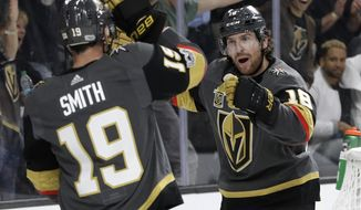 Vegas Golden Knights left wing James Neal, right, celebrates with right wing Reilly Smith after Neal scored against the Arizona Coyotes during the first period of an NHL hockey game Tuesday, Oct. 10, 2017, in Las Vegas. (AP Photo/John Locher)