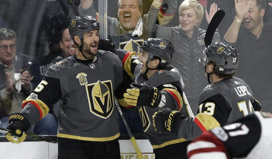 Vegas Golden Knights defenseman Deryk Engelland, left, celebrates after scoring against the Arizona Coyotes during the first period of an NHL hockey game Tuesday, Oct. 10, 2017, in Las Vegas. (AP Photo/John Locher)