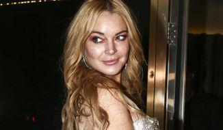 FILE - In this Oct. 16, 2016, file photo, actress Lindsay Lohan appears at the opening night of the Lohan Nightclub in Athens, Greece. Lohan posted a video to Instagram on Oct. 10, 2017, defending fired movie mogul Harvey Weinstein. (AP Photo/Yorgos Karahalis, File)
