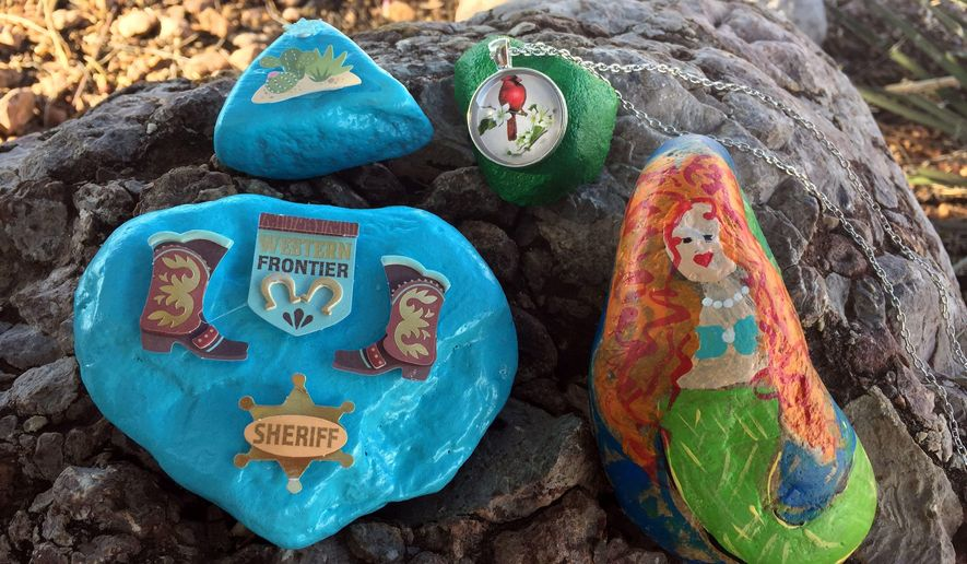 Rocks painted by members of the Alamo Rocks Facebook group are hidden around Alamogordo for other community members to hunt and hide again. These rocks sat outside the Alamogordo Daily News office on Sept. 29 for residents to find. (Tara Melton/Alamogordo Daily News)