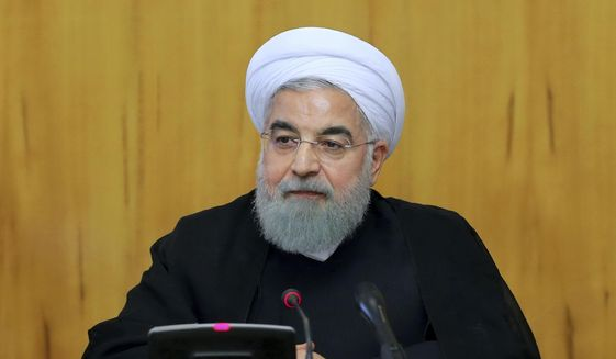 """In this photo released by official website of the office of the Iranian Presidency, President Hassan Rouhani speaks during a cabinet meeting in Tehran, Iran, Wednesday, Wednesday, Oct. 11, 2017. Rouhani said If the U.S. backs out of the nuclear deal, """"it won't be our failure at all, but a failure for the other side. (Iranian Presidency Office via AP)"""