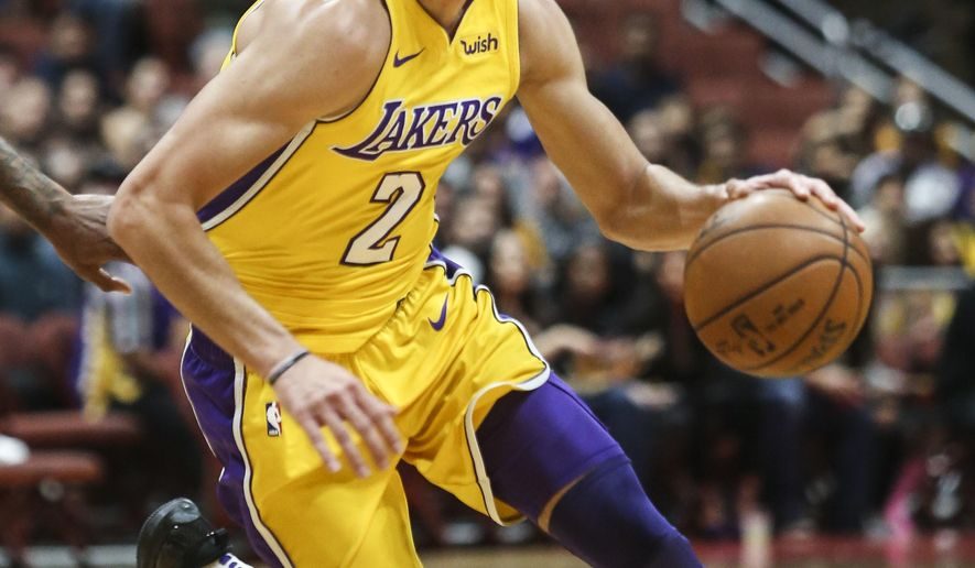 FILE - In this Sept. 30, 2017, file photo, Los Angeles Lakers guard Lonzo Ball (2) drives during an NBA preseason basketball game against the Minnesota Timberwolves, in Anaheim, Calif. Lonzo Ball is receiving attention out of all proportion to his actual accomplishments in basketball. That's the price of playing for the Los Angeles Lakers, and the rookie point guard must learn how to navigate the pressures while growing into his role as the centerpiece of their rebuilding effort.  (AP Photo/Ringo H.W. Chiu, File)