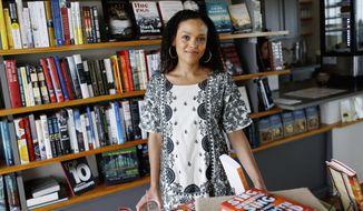 """In this Sept. 19, 2017 photo provided by the John D. and Catherine T. MacArthur Foundation, African-American author Jesmyn Ward, poses for a photo in Pass Christian, Miss. The John D. and Catherine T. MacArthur Foundation announced Wednesday, Oct. 11, 2017, that Ward was one of 24 fellows to receive a """"genius grant"""" from the Chicago-based foundation. (John D. and Catherine T. MacArthur Foundation via AP)"""