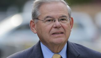 FILE - In this Sept. 6, 2017, file photo, Sen. Bob Menendez arrives to court for his federal corruption trial in Newark, N.J. When the government rests its bribery case against Menendez, the judge will make a crucial ruling on the New Jersey Democrat's motion to dismiss the charges. (AP Photo/Seth Wenig, File)