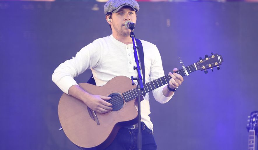 FILE - In this May 13, 2017 file photo, Niall Horan performs at Wango Tango in Carson, Calif. Twickets, a Europe-based face value ticket platform has launched in North America. For upcoming U.S. shows, Twickets will partner with Niall Horan of One Direction, Pixies and PVRIS for their shows. Twickets founder Richard Davies says users have saved other fans more than $20 million in inflated prices and fees for event tickets. (Photo by Chris Pizzello/Invision/AP, File)