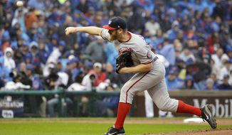Washington Nationals starting pitcher Stephen Strasburg throws during the first inning of Game 4 of baseball's National League Division Series against the Chicago Cubs, Wednesday, Oct. 11, 2017, in Chicago. (AP Photo/Nam Y. Huh)