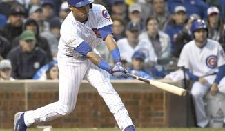 Chicago Cubs' Addison Russell strikes out in the fourth inning against the Washington Nationals in Game 4 of a baseball National League Division Series at Wrigley Field in Chicago on Wednesday, Oct. 11, 2017. (John Starks/Daily Herald via AP)
