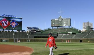 Washington Nationals starting pitcher Stephen Strasburg (37) walks on the field during baseball practice at Wrigley Field, Sunday, Oct. 8, 2017, in Chicago. Game 3 of the National League Division Series between the Nationals and the Chicago Cubs is Monday. (AP Photo/David Banks)