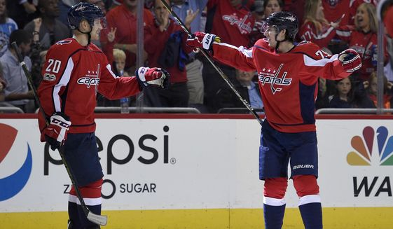 Washington Capitals defenseman Christian Djoos, right, celebrates his goal with center Lars Eller (20) during the second period of an NHL hockey game against the Pittsburgh Penguins, Wednesday, Oct. 11, 2017, in Washington. (AP Photo/Nick Wass)