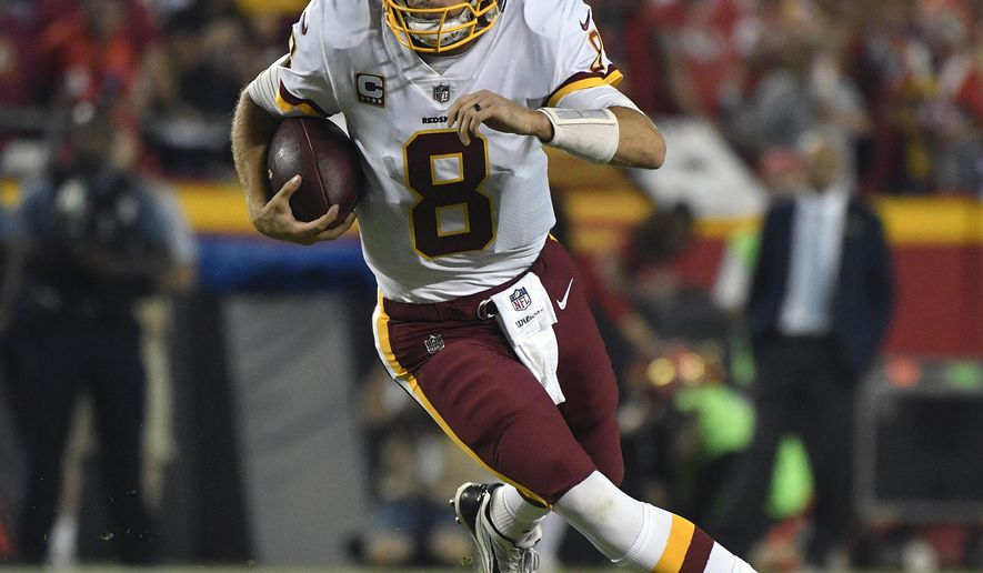 FILE - In this Oct. 2, 2017, file photo, Washington Redskins quarterback Kirk Cousins (8) scrambles during the first half of an NFL football game against the Kansas City Chiefs, in Kansas City, Mo. Facing the first offensive coordinator who believed in him in now San Francisco 49ers coach Kyle Shanahan, Kirk Cousins is still evolving and improving as a quarterback for the Redskins.  (AP Photo/Ed Zurga, File)