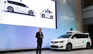 FILE - In this Jan. 8, 2017, file photo John Krafcik, CEO of Waymo Inc., the autonomous vehicle company created by Google's parent company, introduces a Chrysler Pacifica hybrid outfitted with Waymo's own suite of sensors and radar at the North American International Auto Show in Detroit. California regulators have taken an important step to clear the road for everyday people to get self-driving cars. The state's Department of Motor Vehicles on Wednesday, Oct. 11, 2017, published proposed rules that would govern the technology within California, where manufacturers have been testing hundreds of prototypes on roads and highways. (AP Photo/Paul Sancya,File)