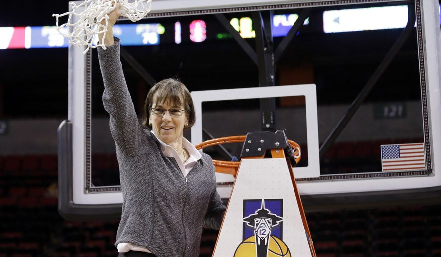 FILE - In this March 5, 2017, file photo, Stanford head coach Tara VanDerveer waves the net after finishing cutting it down after her team beat Oregon State in the Pac-12 Conference championship NCAA college basketball game in Seattle. VanDerveer has signed a three-year contract extension that takes the Hall of Fame Stanford coach through the 2019-20 season. She discussed her deal during Pac-12 media day, Wednesday, Oct. 11, 2017. VanDerveer is just the third Division I coach to reach 1,000 wins. (AP Photo/Elaine Thompson, File)