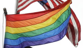 The Rainbow Flag flies beneath the American flag at the Stonewall National Monument, Wednesday, Oct. 11, 2017, in New York. (AP Photo/Mark Lennihan) ** FILE **