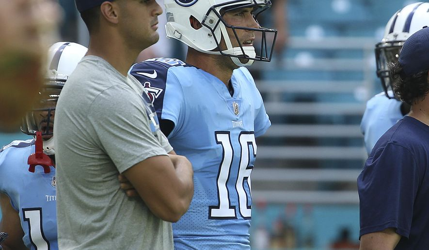 FILE - In this Oct. 8, 2017, file photo, Tennessee Titans quarterback Marcus Mariota (8) watches the warms up with quarterback Matt Cassel (16) before an NFL football game against the Miami Dolphins, in Miami Gardens, Fla. The Titans hit the field for an extra workout late Wednesday afternoon, Oct. 11, 2017,  with all eyes watching Marcus Mariota to see if at least one starting quarterback will be available Monday night against the Colts. (AP Photo/Joel Auerbach, File)
