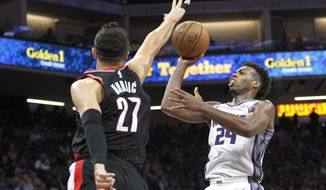 Sacramento Kings guard Buddy Hield (24) shoots over Portland Trail Blazers defender Jusuf Nurkic during the second half of an NBA preseason basketball game in Sacramento, Calif., Monday, Oct. 9, 2017. The Trail Blazers won 97-83.(AP Photo/Steve Yeater)
