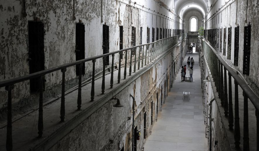 "FILE - In this Sept. 27, 2013, file photo, Eastern State Penitentiary in Philadelphia is shown. The penitentiary took in its first inmate in 1829, closed in 1971 and reopened as a museum in 1994. The site is mentioned in the book ""Ghostland: An American History in Haunted Places."" (AP Photo/Matt Rourke, File)"