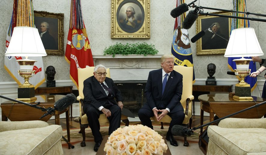 President Donald Trump speaks during a meeting with former Secretary of State Henry Kissinger in the Oval Office of the White House, Tuesday, Oct. 10, 2017, in Washington. (AP Photo/Evan Vucci)