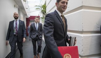 Speaker of the House Paul Ryan, R-Wis., walks to a meeting with House Republicans at the Capitol in Washington, Wednesday, Oct. 11, 2017.  (AP Photo/J. Scott Applewhite)