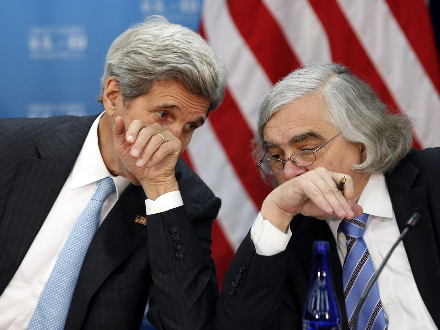 In this May 4, 2016, file photo, Secretary of State John Kerry, left, speaks with Secretary of Energy Ernest Moniz at the State Department in Washington. Former Obama administration officials who played central roles in brokering the Iran nuclear agreement are scheduled to brief congressional Democrats on the merits of the international accord as President Donald Trump prepares to announce a decision that could lead to an unraveling of the pact.  (AP Photo/Alex Brandon)