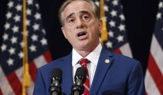 """In this Aug. 16, 2017 photo, Veterans Affairs Secretary David Shulkin speaks during a press briefing in Bridgewater, N.J. The Department of Veterans Affairs has abruptly dropped plans to suspend an ethics law barring employees from receiving benefits from for-profit colleges. The move comes after criticism from government watchdogs, who warned of financial entanglements between government and the private companies vying for millions in GI Bill tuition. In a statement to The Associated Press, the VA said it had received """"constructive comments"""" and as a result would delay action.   (AP Photo/Pablo Martinez Monsivais)"""