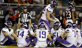 "FILE - In this Monday, Oct. 9, 2017, file photo, Minnesota Vikings tight end Kyle Rudolph (82) celebrates a touchdown with his teammates during the second half of an NFL football game against the Chicago Bears in Chicago. Rudolph initiated a humorous group celebration of his touchdown catch on Monday night with a brief rendition of the children's game ""Duck, Duck, Goose"" in the end zone. Except in Minnesota, the only state where this is the case, the game is called ""Duck, Duck, Gray Duck."" (AP Photo/Darron Cummings, File)"