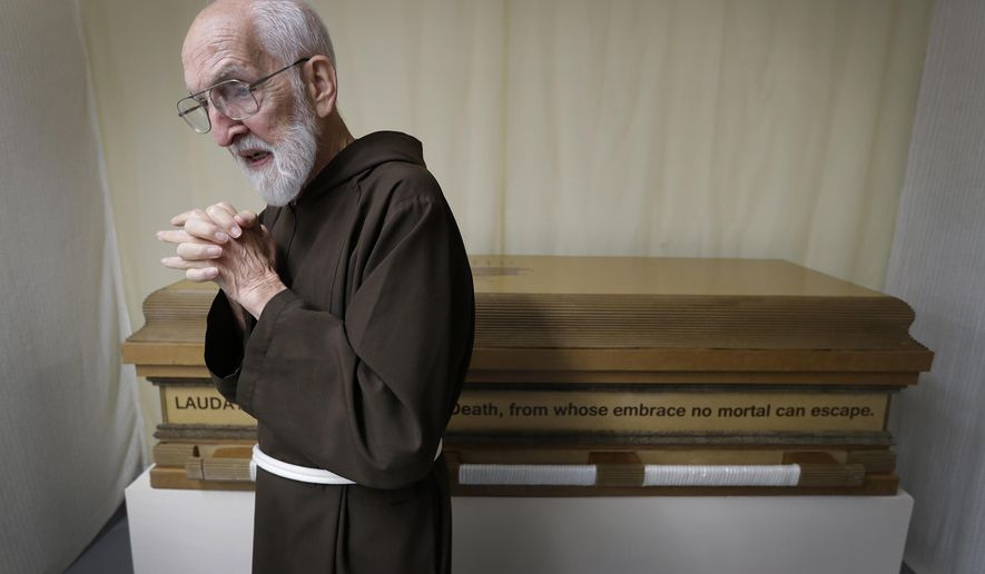 A Tuesday, Sept. 26, 2017 photo shows Robert Udulutsch, a retired Capuchin friar who made his own casket out of biodegradable scrap materials in Appleton, Wis. (Dan Powers/The Post-Crescent via AP)