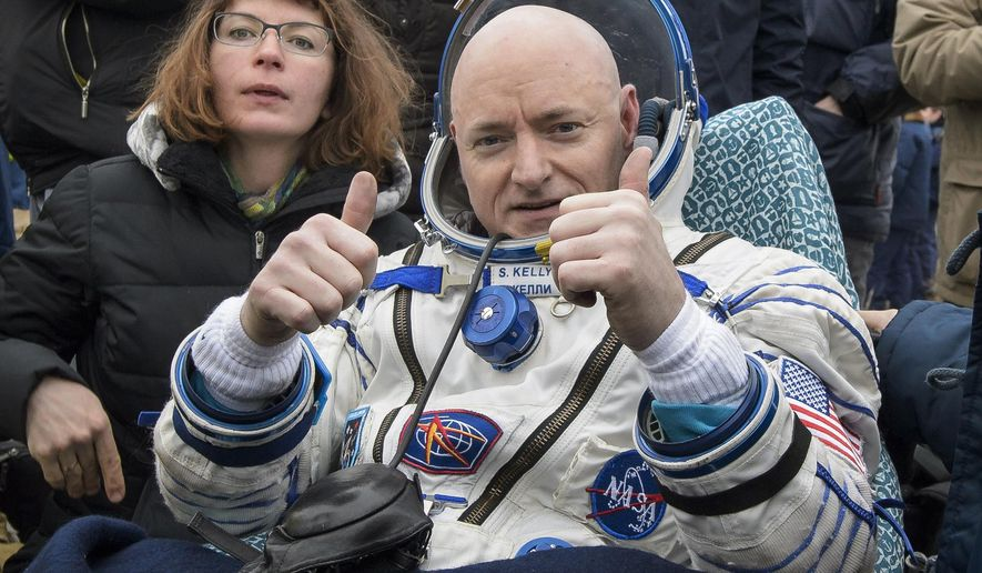 FILE - In this Wednesday, March 2, 2016 photo provided by NASA, International Space Station (ISS) crew member Scott Kelly of the U.S. reacts after landing near the town of Dzhezkazgan, Kazakhstan. In his new autobiography, the retired astronaut writes about his U.S. record-breaking year in space and the challenging life events that got him there. (Bill Ingalls/NASA via AP)