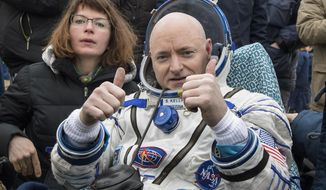 In this Wednesday, March 2, 2016 photo provided by NASA, International Space Station (ISS) crew member Scott Kelly of the U.S. reacts after landing near the town of Dzhezkazgan, Kazakhstan. In his new autobiography, the retired astronaut writes about his U.S. record-breaking year in space and the challenging life events that got him there. (Bill Ingalls/NASA via AP)