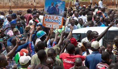 lead in National Super Alliance (NASA) supporters holding poster of opposition leader Raila Odinga and his running mate Kalonzo Musyoka demonstrate in Nairobi, Kenya, Wednesday Oct. 11, 2017. The protesters are demanding a change of leadership at the country's election commission. The protests took place in the capital Nairobi and the opposition stronghold of Kisumu, in western Kenya, as well as in the coastal city of Mombasa.(AP Photo/Sayyid Abdul Azim) (credit)