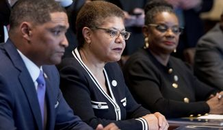 From left: Congressional Black Caucus Chairman Rep. Cedric Richmond, D-La., Rep. Karen Bass, D-Calif., Rep. Gwen Moore, D-Wis., and other members of the Congressional Black Caucus meet with President Donald Trump in the Cabinet Room of the White House in Washington on March 22, 2017. (Associated Press) **FILE**