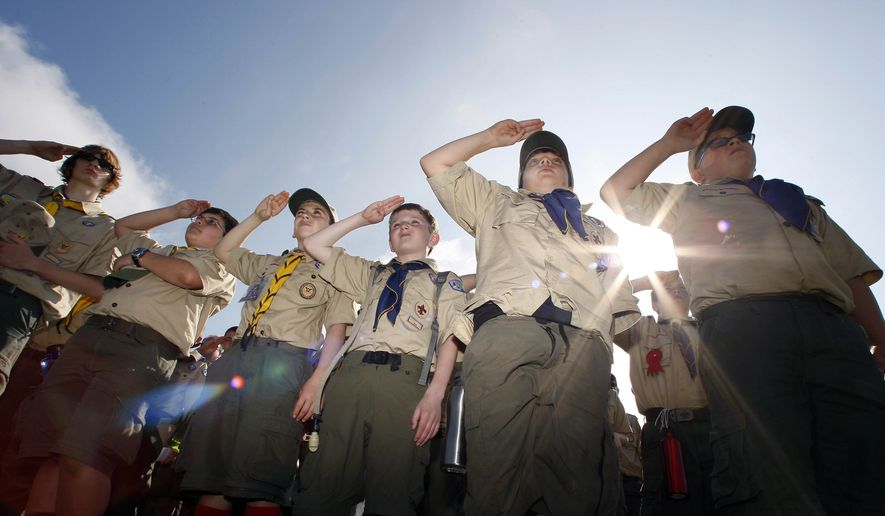 "FILE - In this Saturday morning, May 21, 2011 file photo, Boy Scouts salute during a ""camporee"" in Sea Girt, N.J. The Wednesday, Oct. 11, 2017 Boy Scouts of America announcement to admit girls throughout its ranks will transform what has been a mostly cordial relationship between the two iconic youth groups since the Girl Scouts of the USA was founded in 1912, two years after the Boy Scouts. (AP Photo/Mel Evans)"