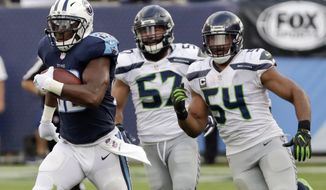 FILE - In this Sept. 24, 2017, file photo, Tennessee Titans running back DeMarco Murray, left, leaves Seattle Seahawks defenders behind as he scores on a 75-yard touchdown run in the second half of an NFL football game in Nashville, Tenn. The Titans want to get back to running the ball to jump start an offense that has sputtered too much this season. (AP Photo/James Kenney, File)