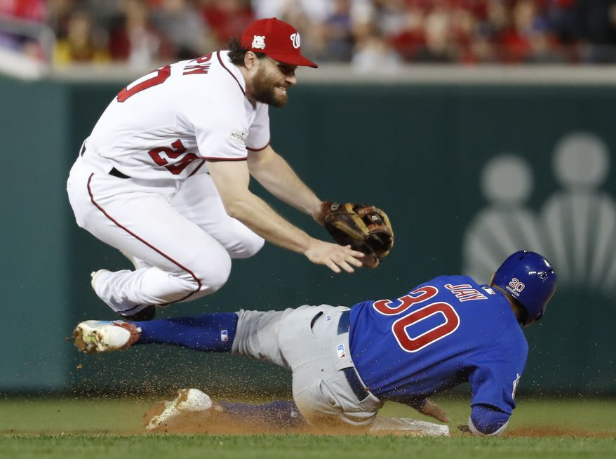 Washington Nationals second baseman Daniel Murphy (20) jumps after forcing out Chicago Cub's Jon Jay (30) on a ball hit by Kris Bryant, who was safe at first during seventh the inning of Game 5 of a baseball National League Division Series, at Nationals Park, Thursday, Oct. 12, 2017, in Washington. Kyle Schwarber scored on the play. (AP Photo/Alex Brandon) ** FILE **