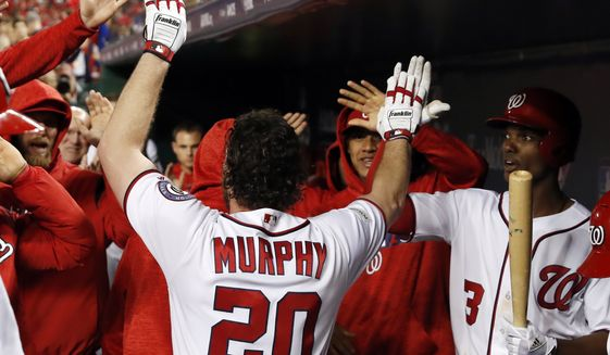 Washington Nationals' Daniel Murphy (20) celebrates his solo home run in the second inning of Game 5 of baseball's National League Division Series against the Chicago Cubs, at Nationals Park, Thursday, Oct. 12, 2017, in Washington. (AP Photo/Alex Brandon)