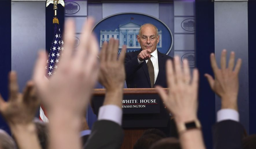 A calm White House chief of staff John Kelly wrangles the press corps on Thursday afternoon. (AP Photo/Susan Walsh)