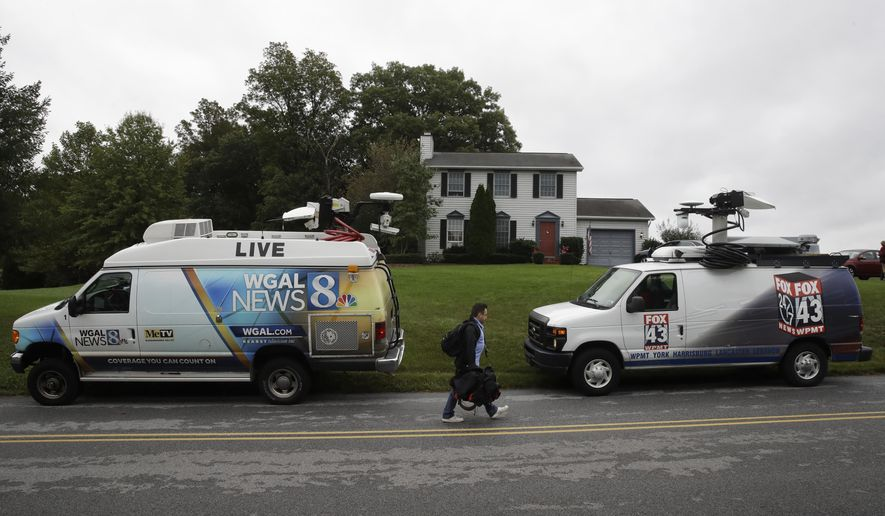 Members of the media gather outside the home of Jim and Lyn Coleman, parents of Caitlan Coleman, on Thursday, Oct. 12, 2017, in Stewartstown, Pa. Caitlan Coleman, her Canadian husband and their three young children have been released after years held captive by a group that has ties to the Taliban and is considered a terrorist organization by the United States, U.S. and Pakistani officials said Thursday. (AP Photo/Matt Rourke)