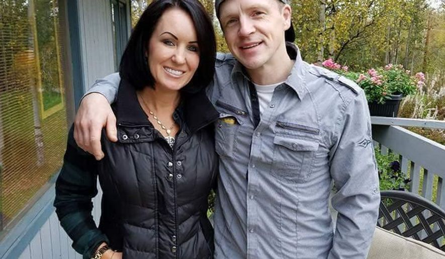 This Sept. 20, 2016, photo provide by Scott Smith shows Krista Smith, left, and her brother, Micah McComas in Chugiak, Alaska. Krista Smith said Thursday, Oct. 12, 2017, that the family has many unanswered questions after her brother was killed by a Seward, Alaska, police officer on Oct. 1, 2017. (Scott Smith via AP)